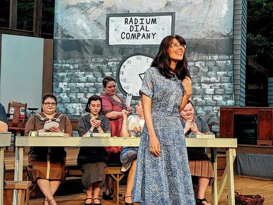 """Jennifer Dennison portrays Catherine Donahue in a scene from """"These Shining Lives"""" during rehearsals at Theatre in the Park at Lincoln's New Salem State Historic Site in Petersburg. The play looks at the so-called """"Radium Girls,"""" factory workers in the 1920s and '30s who used a toxic radium compound to paint glow-in-the-dark hour markings on watch faces. Photo: Photo Provided"""
