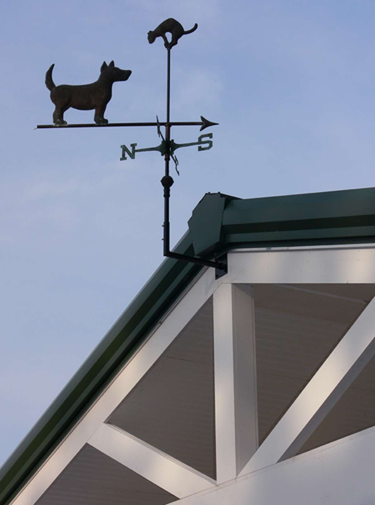 A dog-and-cat weathervane near the new shelter's front roof was purchased by Animal Shelter Building Committee member Linda Hooper at an antique store.