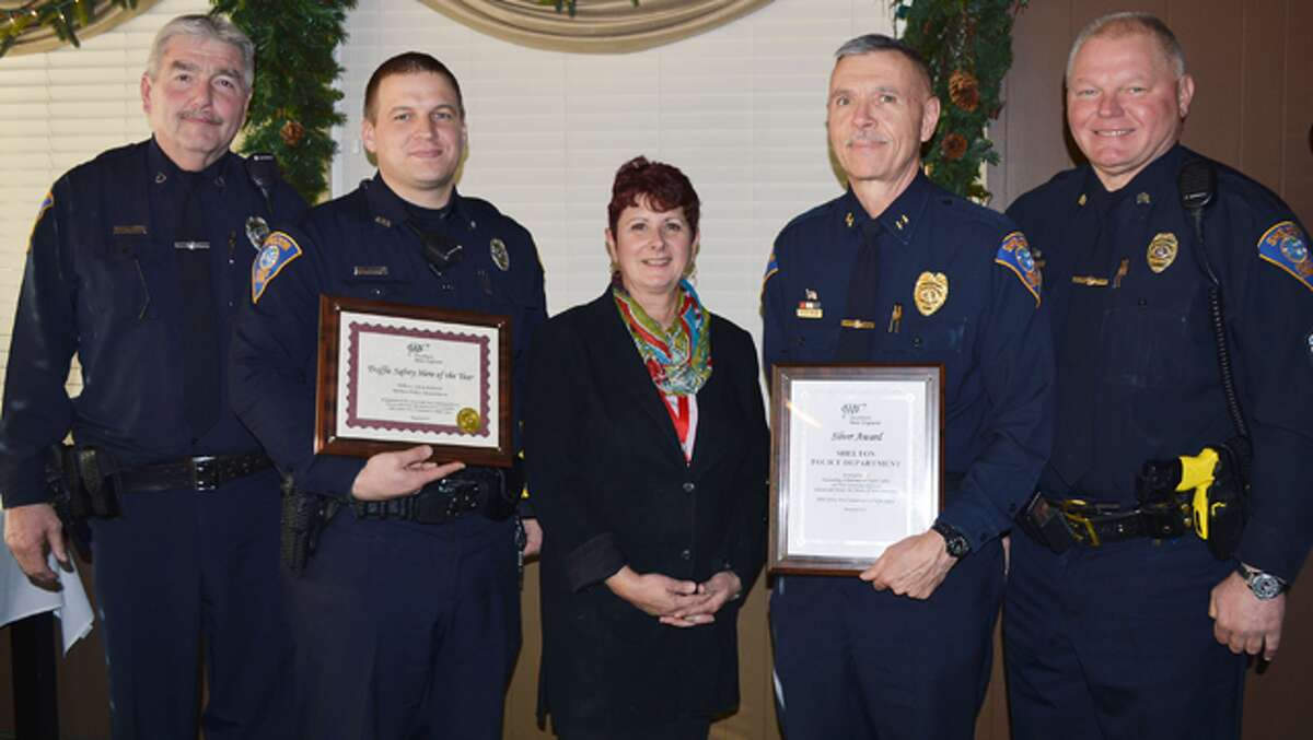 At the AAA awards luncheon are, from left, Shelton police officer Mark Siglinger, officer Chris Roback, AAA Public Affairs Manager Fran Mayko, Police Chief Joel Hurliman and Sgt. Pete Zaksewicz. Siglinger and Zaksewicz are certified AAA driving improvement program instructors.