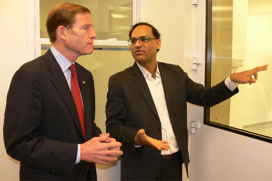 U.S. Sen. Richard Blumenthal, left, and Anil R. Diwan, president of NanoViricides Inc., discuss the company's research into finding an Ebola treatment during a tour of its Shelton facility.