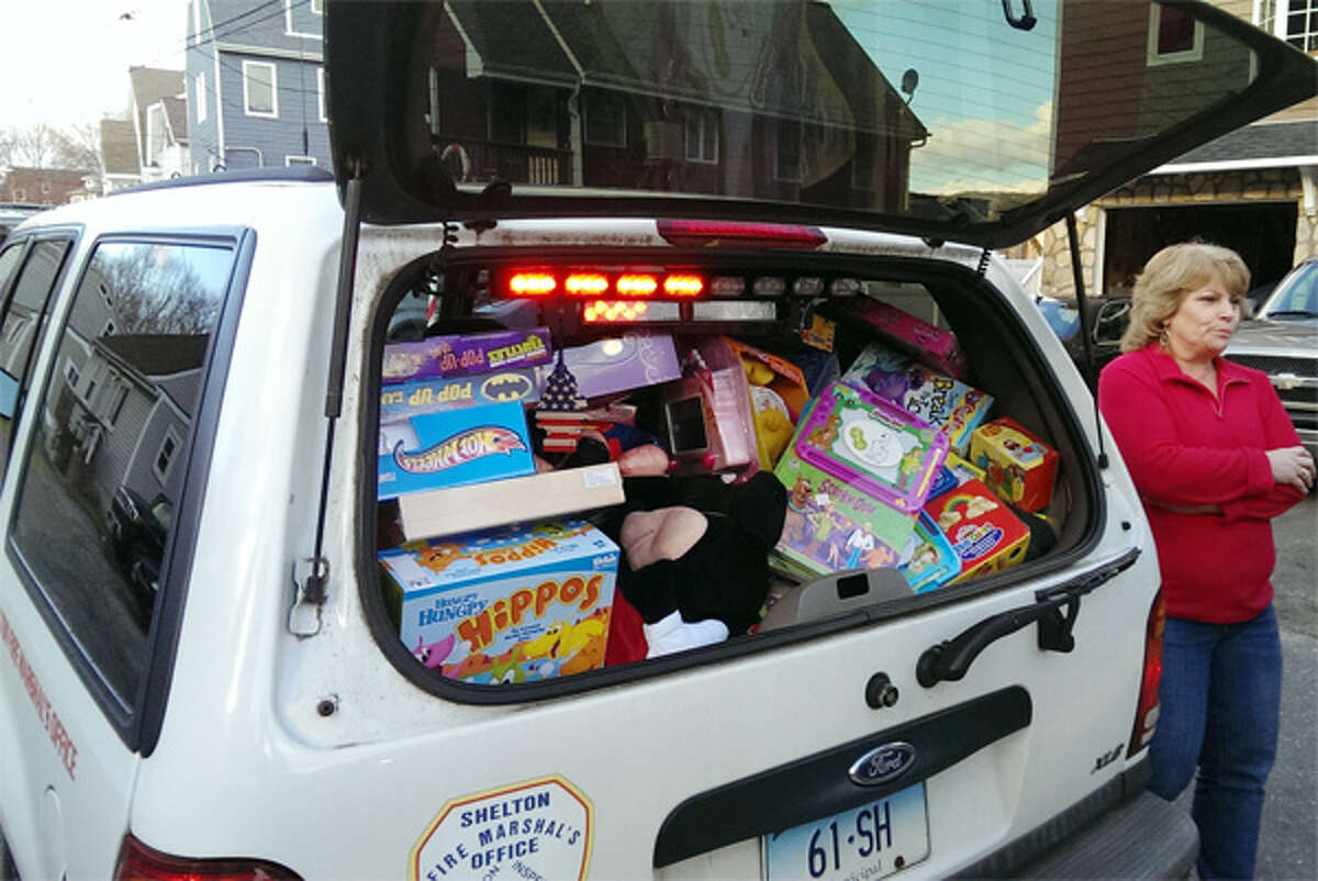 The toys donated by people in the neighborhood fill the back of a Fire Department vehicle.