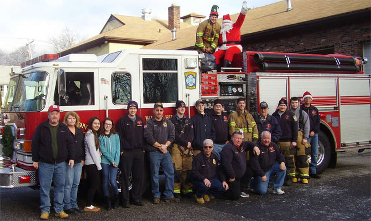 Santa and his crew with the White Hills firetruck used to ride through the neighborhood to collect toys.