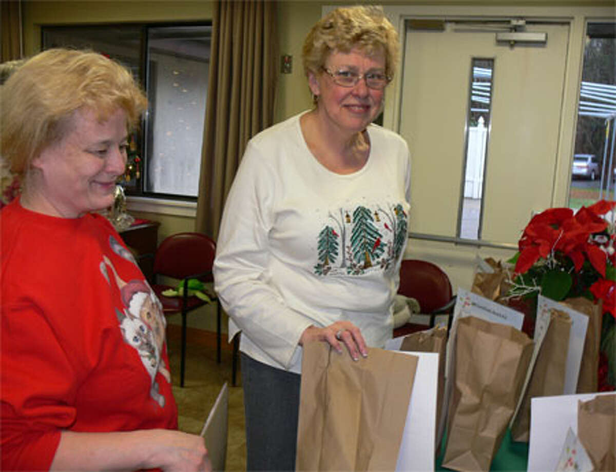 Carol Tonucci, left, and Donna Skurat, both of Shelton, prepare raffle items for the Festival of Trees. This year's event was held in memory of Donna's late husband, Matt Skurat, who was the festival's first coordinator and Echo Hose secretary. He died in 2013.