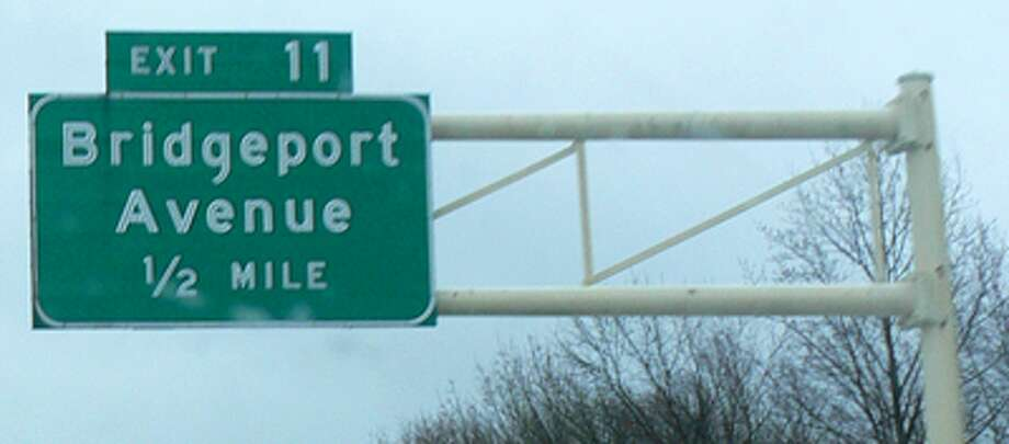 Exit signs such as this one in Shelton on Route 8 will have new exit numbers, to be based in mileage, in the future.