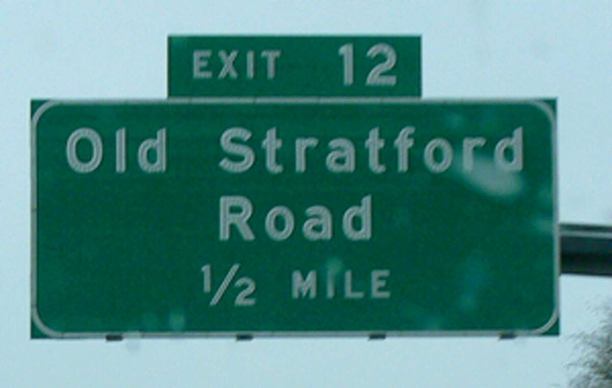 Exit signs such as this one in Shelton on Route 8 will display new exit numbers, to be based in mileage, in the future.