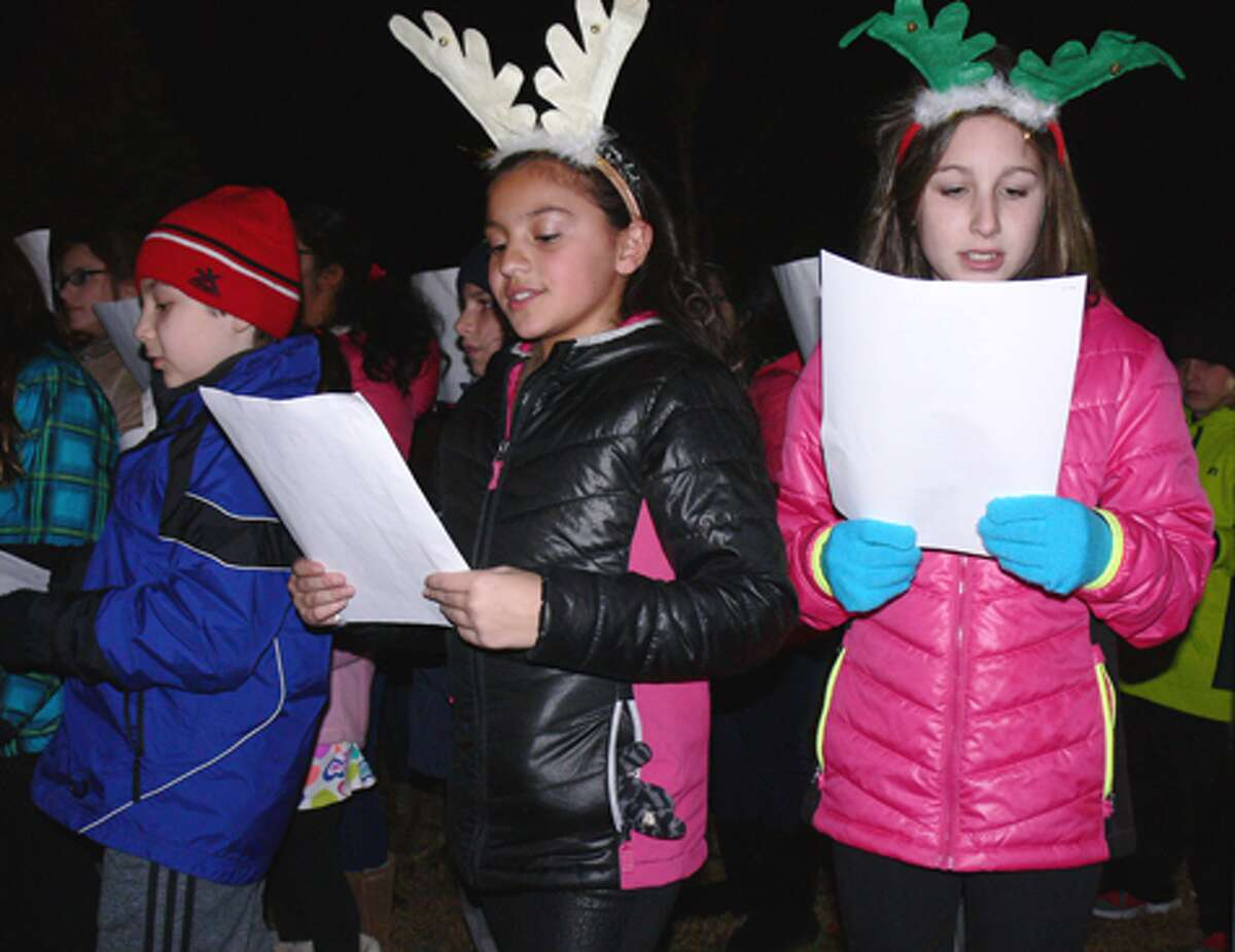 Perry Hill School students perform Christmas carols at the White Hills tree-lighting ceremony.