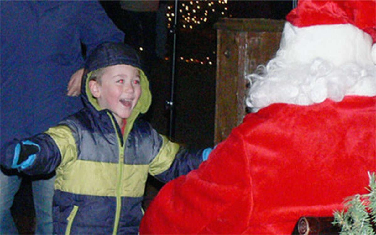 A young boy meets Santa at the 2013 Huntington Green tree-lighting ceremony.