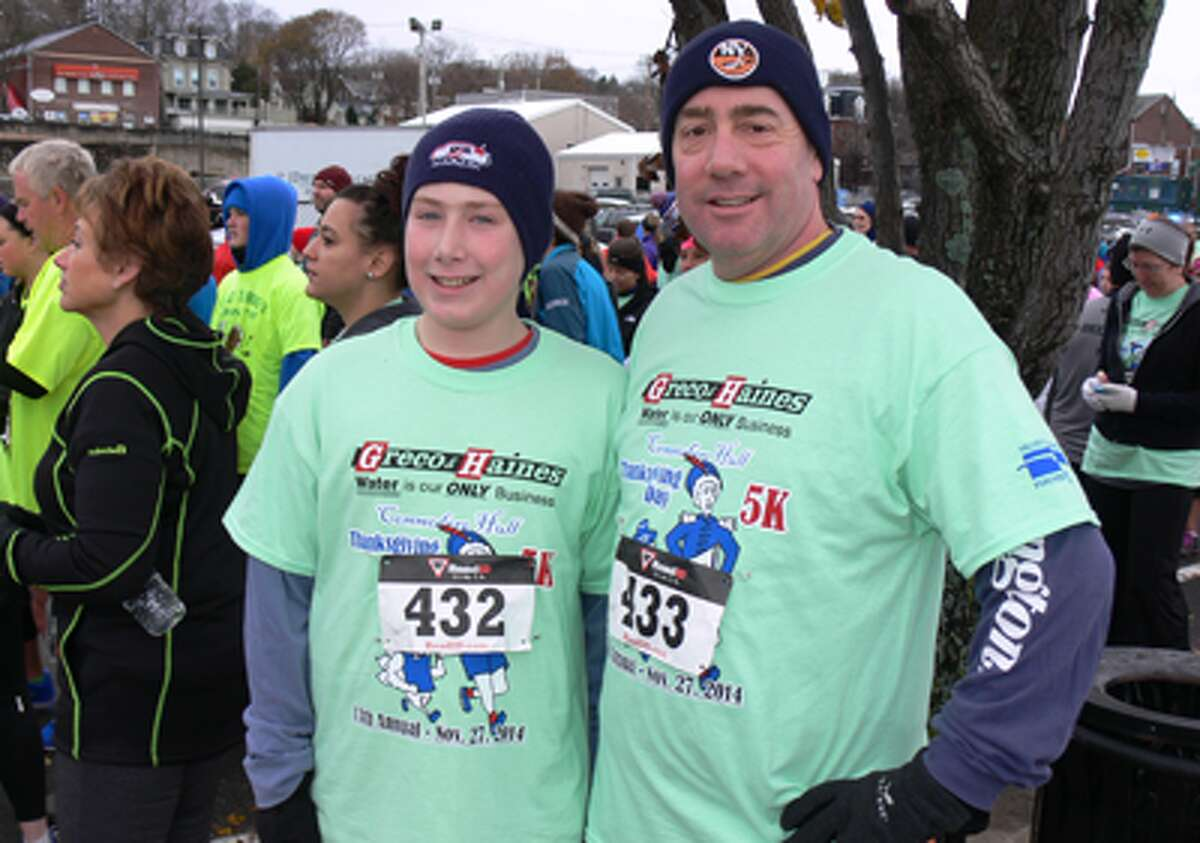 Charles Manger, 13, and his dad, Rob, of Shelton at the starting line.