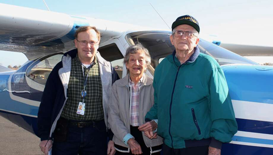 From left, pilot George Clark with Crosby Commons residents Helen Carlson and Bob Shields.