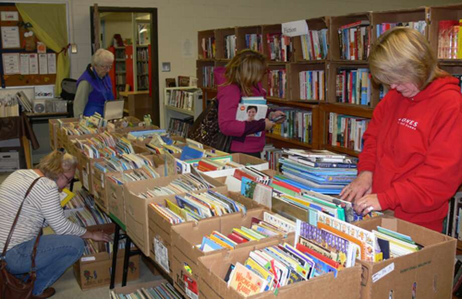 Browsers at the Plumb Memorial Library book sale.