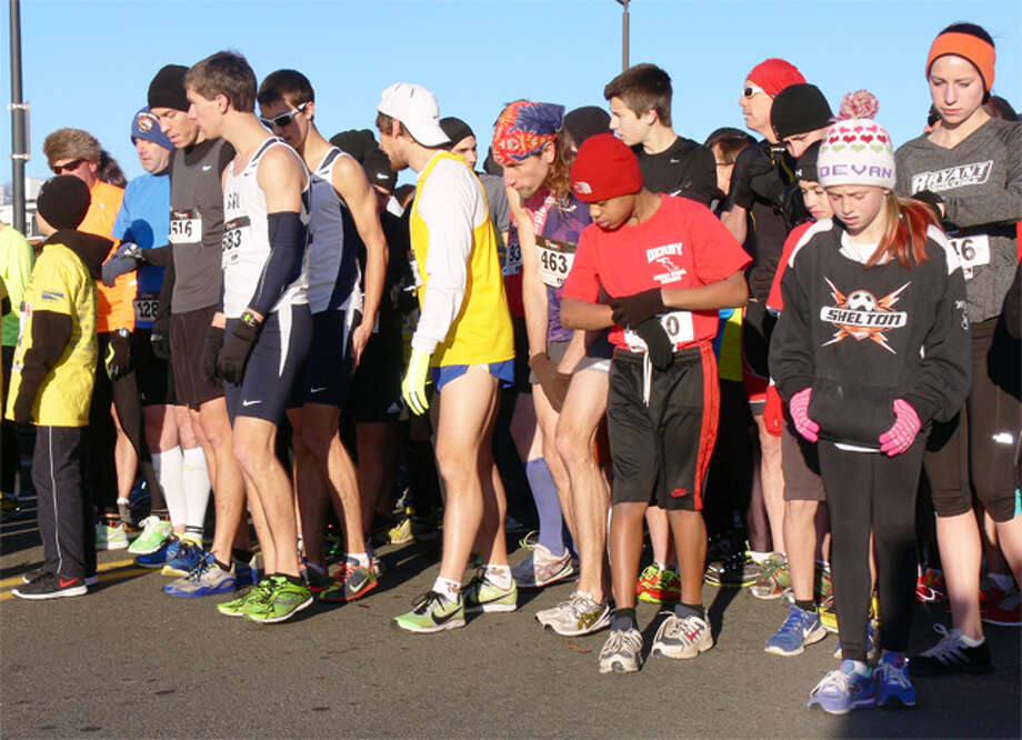 Runners at the start of the 2013 Commodore Hull Thanksgiving Day 5K Road Race in Shelton, near the Riverwalk.