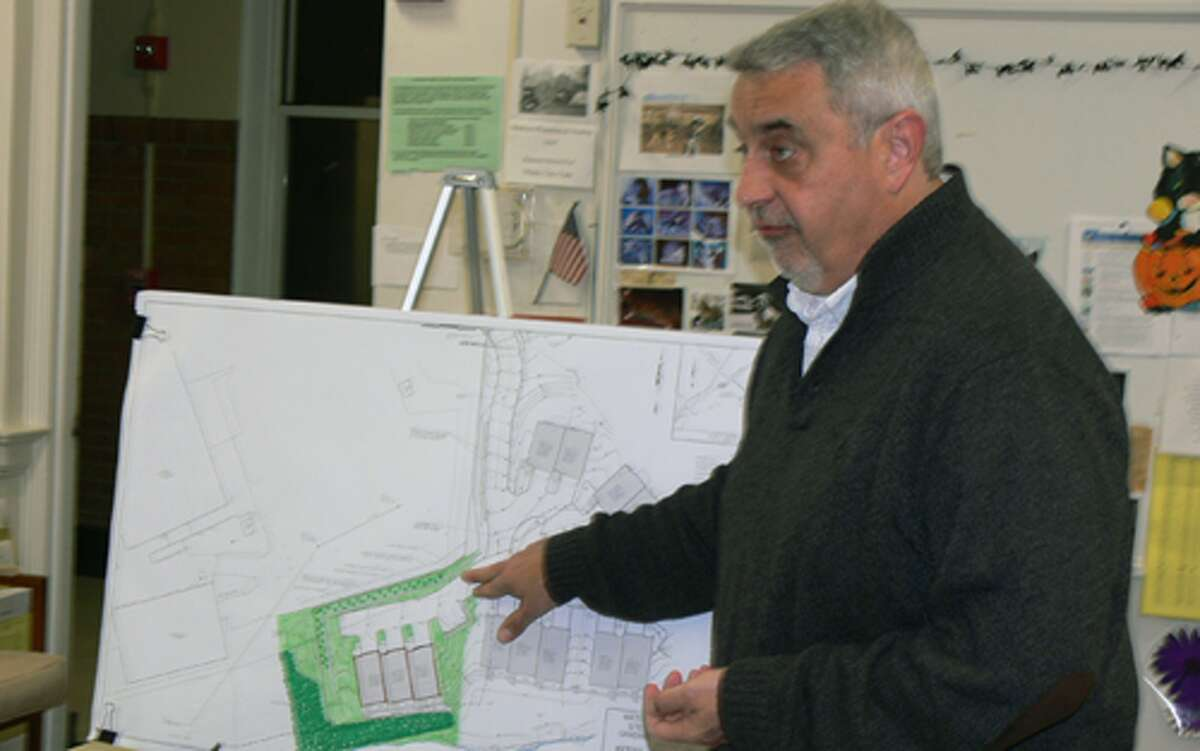 Engineer Dennis McMorrow explains the revised Water's Edge application to the Shelton Inland Wetlands Commission.