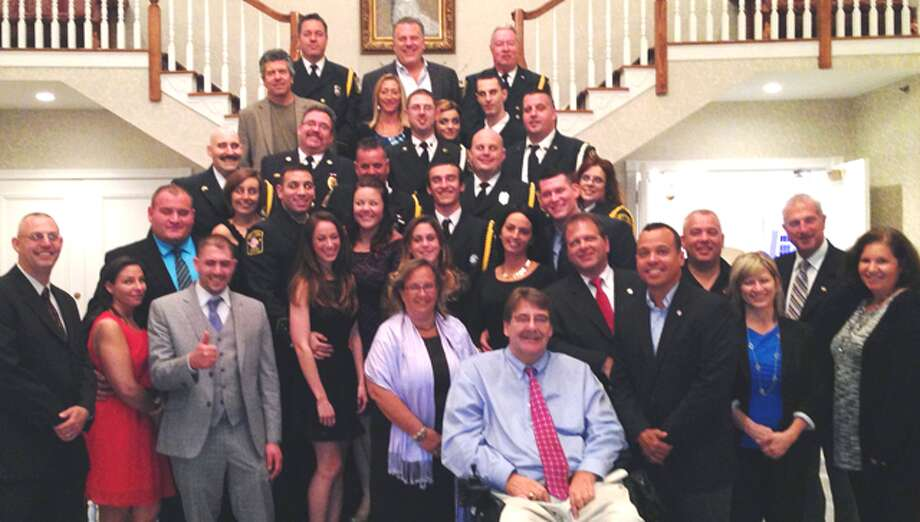 Shelton firefighters, friends, family, city officials and local Exchange Club members at the statewide Salute to Connecticut's Bravest event, where 12 Shelton fire personnel were honored.