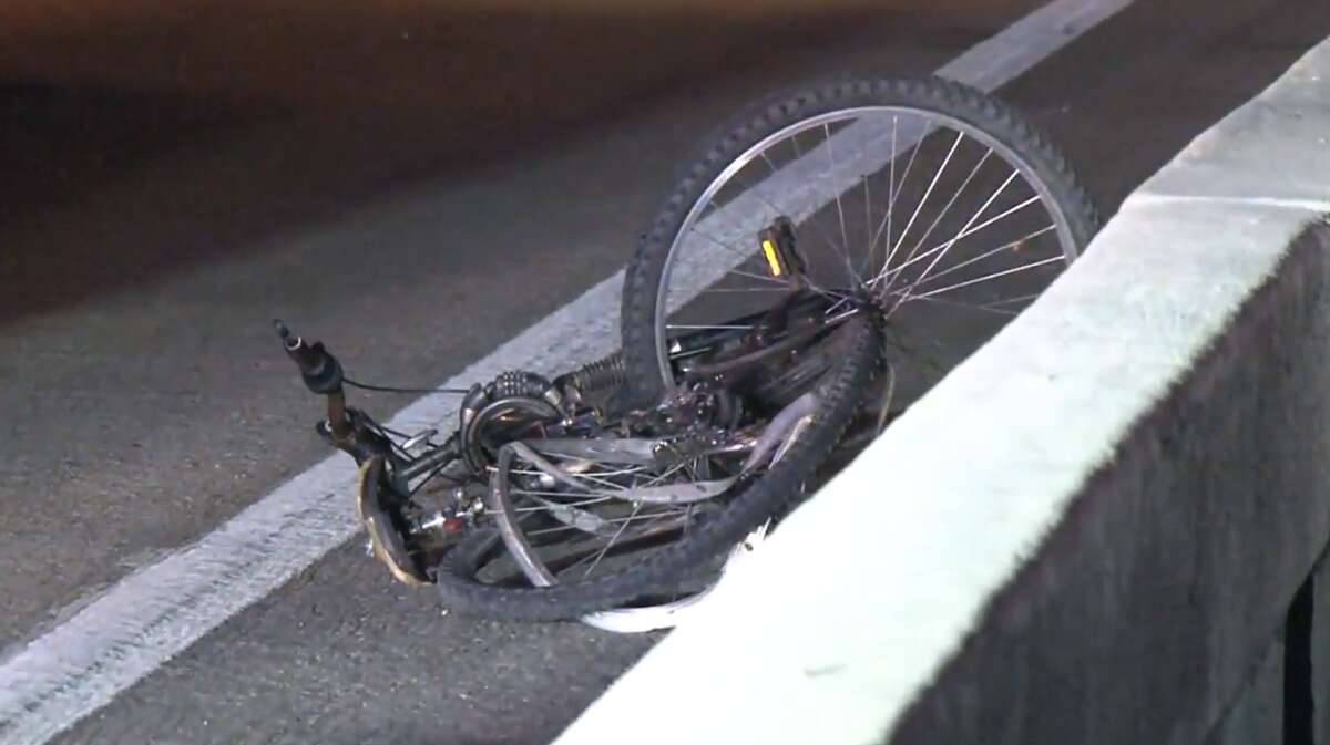 Harris County Sheriff's Office deputies respond to a fatal hit-and-run involving a cyclist Thursday morning, June 6, on the North Freeway exit ramp near Greens Road.