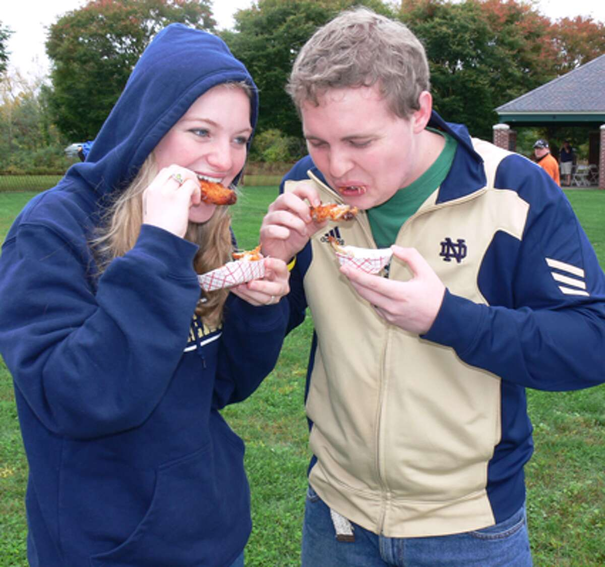 Sarah and husband Brad Crilley of Derby show they know how to down some wings.