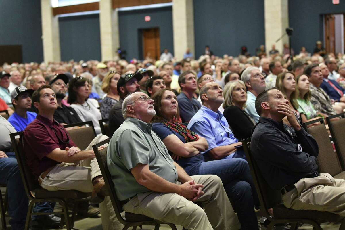 People look at a presentation about possible solutions to the damaged dam at Lake Dunlap during a Preserve Lake Dunlap Association meeting at the New Braunfels Convention Center on June 5, 2019. A crowd of 900 attended. Part of the dam that forms Lake Dunlap on the Guadalupe River collapsed May 14.