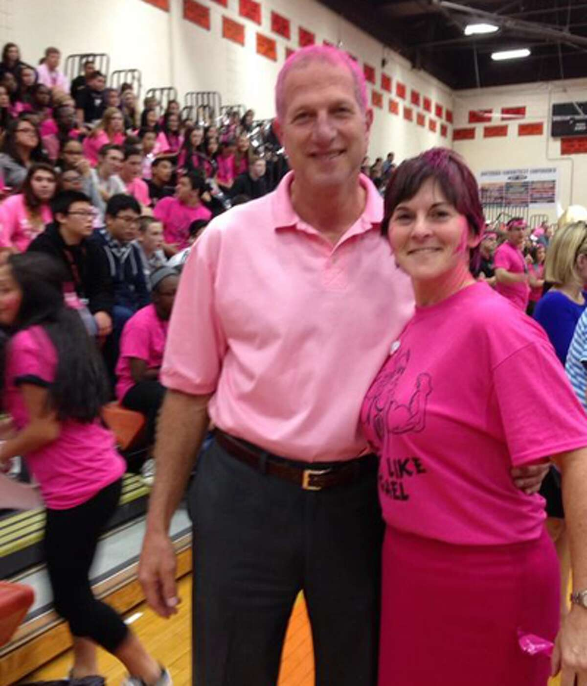 Mayor Mark Lauretti joined the fun by having his hair painted pink. Here he's with Shelton High Headmaster Beth Smith during the rally at the high school.