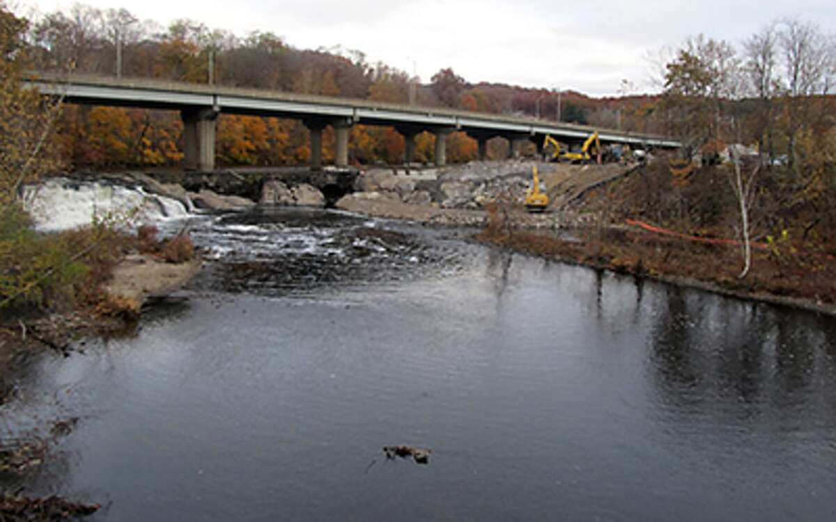 The Naugatuck River flows 40 miles in Connecticut, from Winchester to Derby.