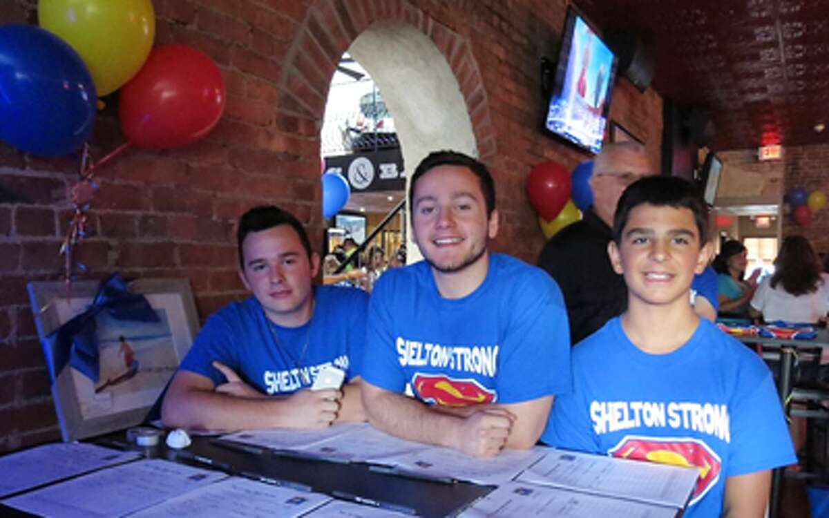 Attendees at an earlier event in Shelton to help young