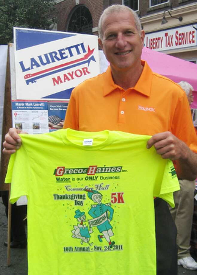 Mayor Mark Lauretti with a Commodore Hull Thanksgiving Day 5K Road Race T-shirt.