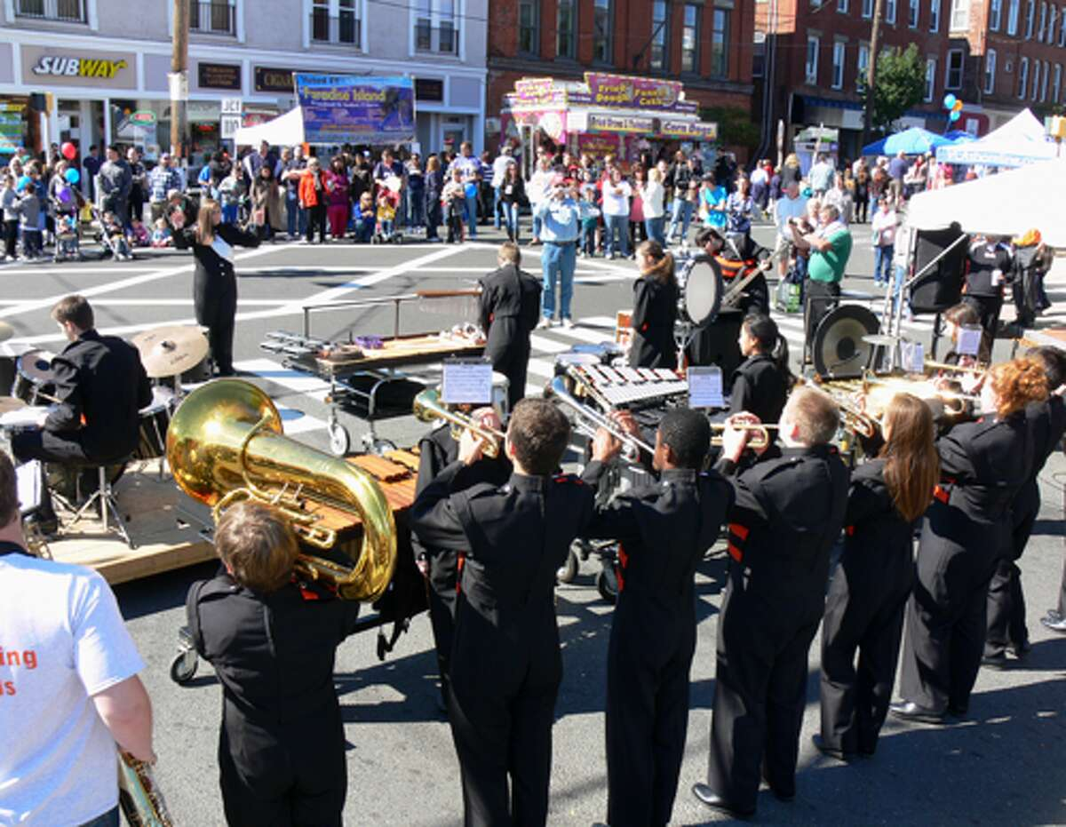 The Shelton High School marching band performs during a Shelton Day ceremony on Howe Avenue.