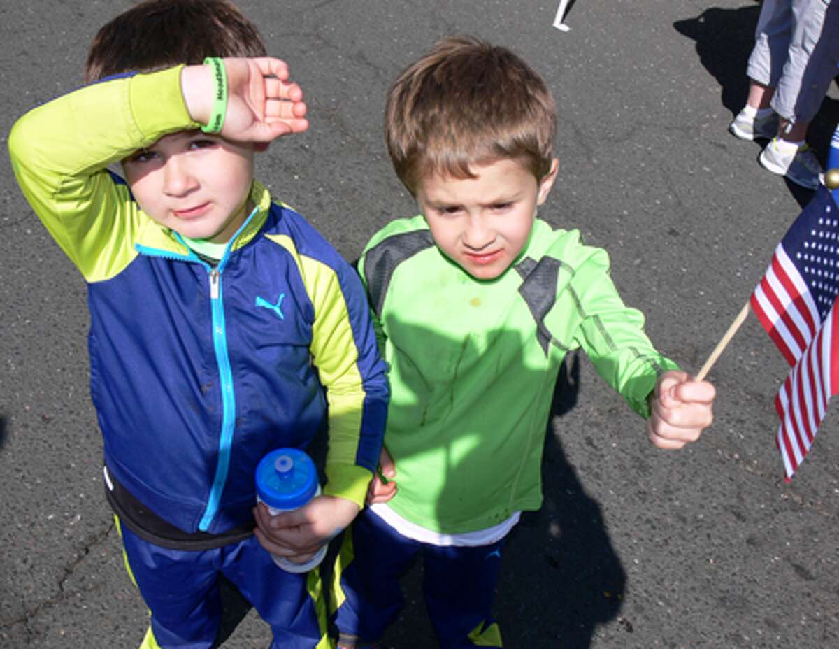 Alexander, right, and twin brother Michael Obied, 5, of Shelton show their patriotism while walking down Howe Avenue.