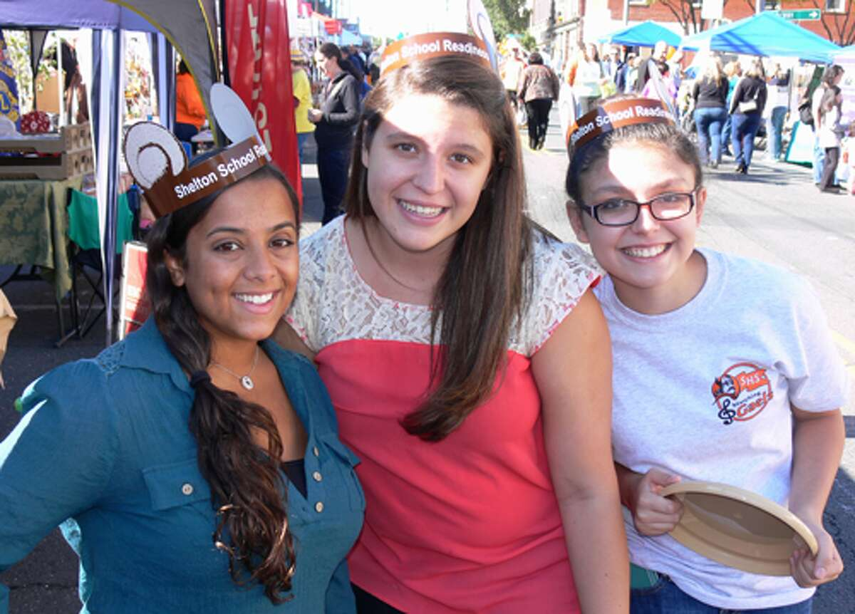 From left, Karyna Perez, a 2011 Shelton High graduate; Michelle Guedes, a 2012 Shelton High graduate, and Britney Guedes, a ninth-grader at the regional Fairchild Wheeler Science Magnet School and Michelle's sister, are all smiles at Shelton Day.