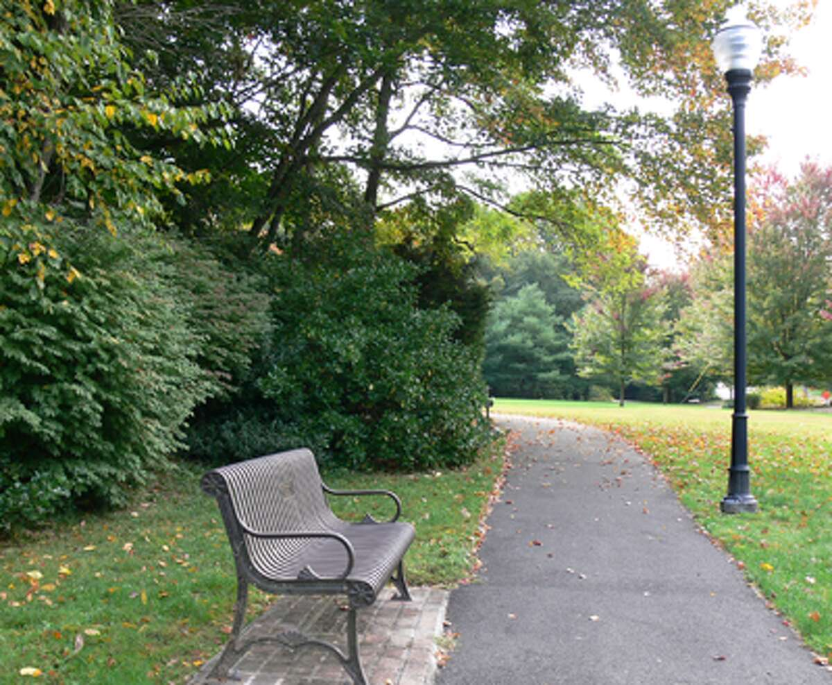 A bench and walkway in the 1.25-acre Constitution Park, a site in Shelton that at one point could have become a 24-hour gas station.