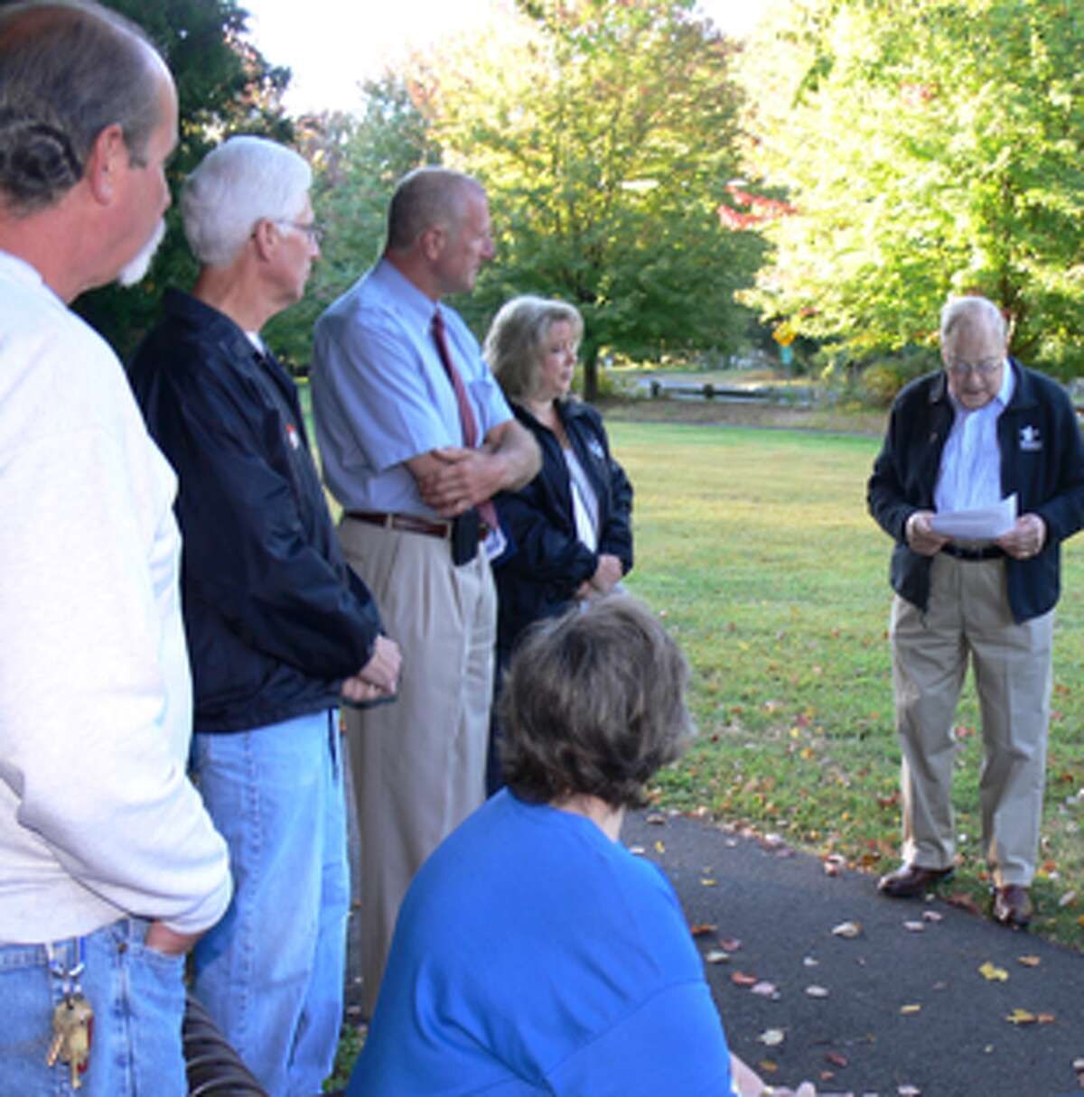 Regis Dognin, one of the neighbors involved in creating Constitution Park, talks at an event to mark the park's 10-year anniversary.