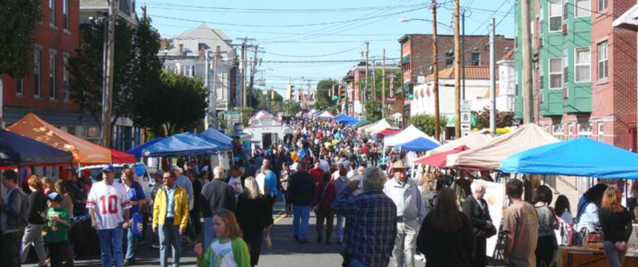 Hundreds of people fill Howe Avenue at the 2014 Shelton Day, which was boosted by ideal weather.