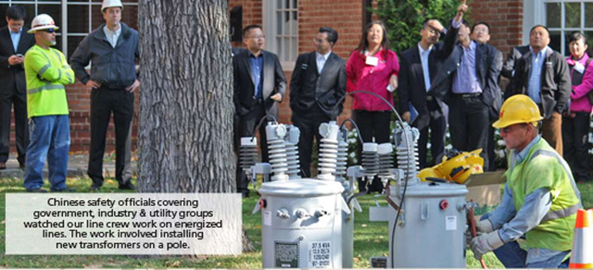 A United Illuminating crew demonstrates how they safely work on energized overhead wires.