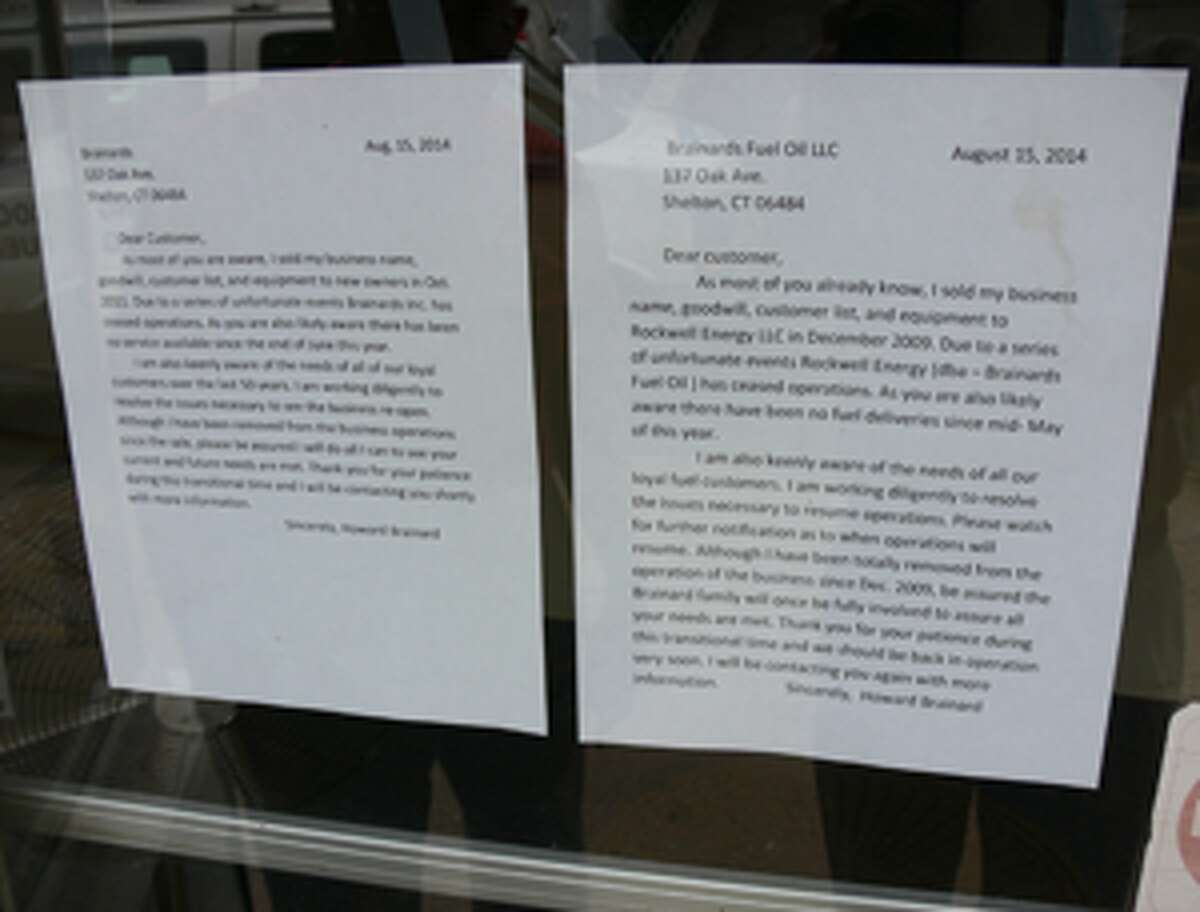 Two letters for customers by Howard Brainard are taped to the front door of the closed office.
