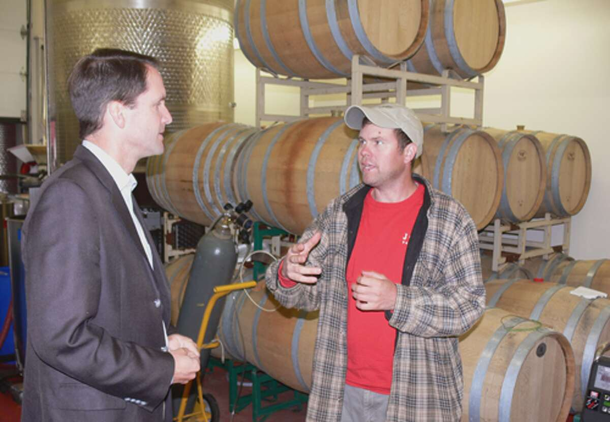 Jamie Jones, right, describes the winery operation to Congressman Jim Himes. The winery's production facility now is being doubled in size.