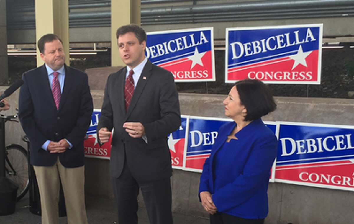 Dan Debicella, center, candidate for Congress, is joined by state Senate Minority Leader John McKinney and state Sen. Toni Boucher while releasing his transportation plan at the Westport train station. All three are Republicans.