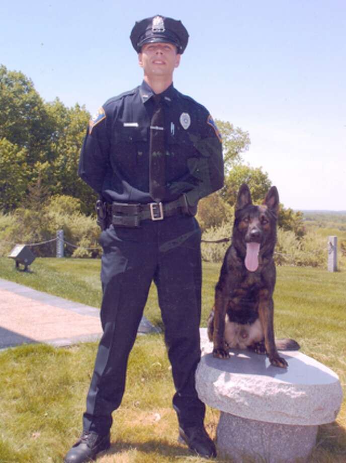 Shelton police officer Christopher Nugent, who is now a detective, with K-9 Jager, who has just retired from the force.