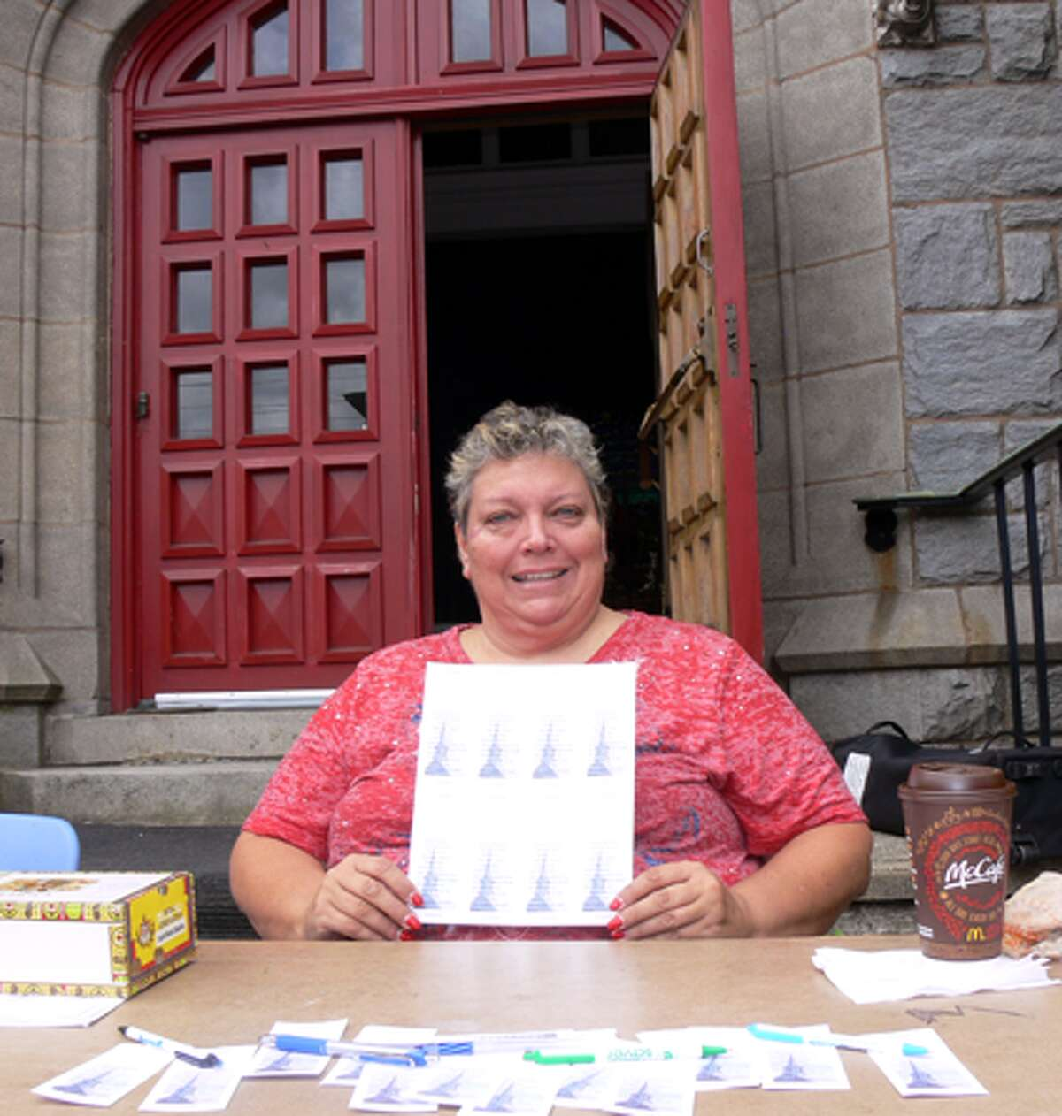 Diane Goodman holds up raffle information at the Shepherd Fall Fair in Shelton, which she helped to organize as an active member of the local Episcopal church.