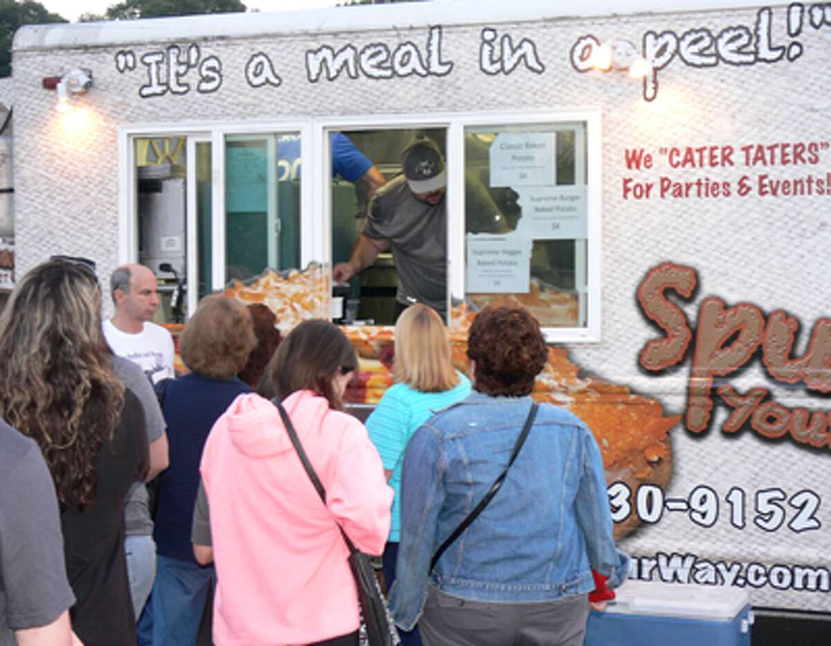 People wait in line at the Spud Your Way truck.