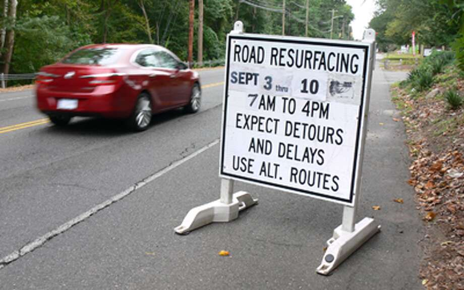 A road work sign, photographed on Sept. 11, indicates motorists can expect delays on lower Bridgeport Avenue in Shelton.
