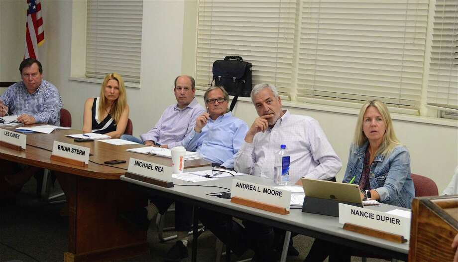 Board of Finance members listen to Mark Mathias, chairman of the Board of Education, explain the state of things regarding CMS, Wednesday night, June 5, 2019, in Westport, Conn. Photo: Jarret Liotta / For Hearst Connecticut Media / Westport News Freelance