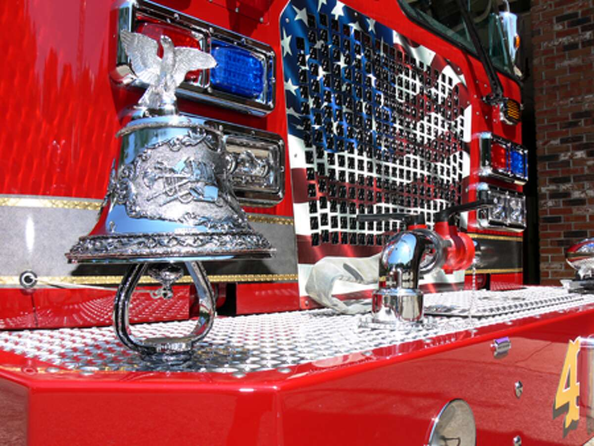 A decorative bell on the top of the front bumper on one of the new Shelton fire trucks.