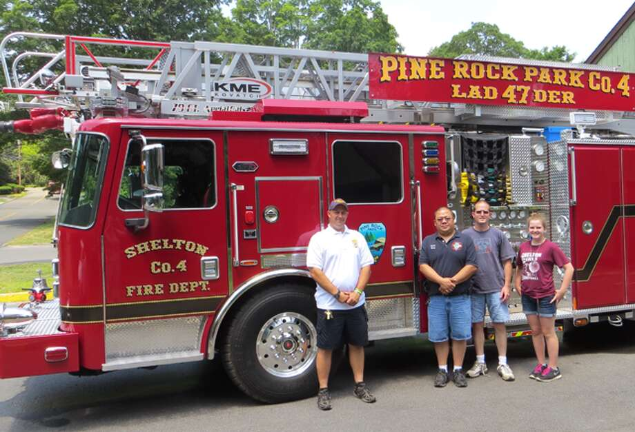 From left, Pine Rock Park Fire Company Asst. Chief Nick Verdicchio, Capt. Carlos Chang, 2nd Lt. Jack Brand and Abby Brand stand beside the company's newest piece of equipment, Ladder 47.