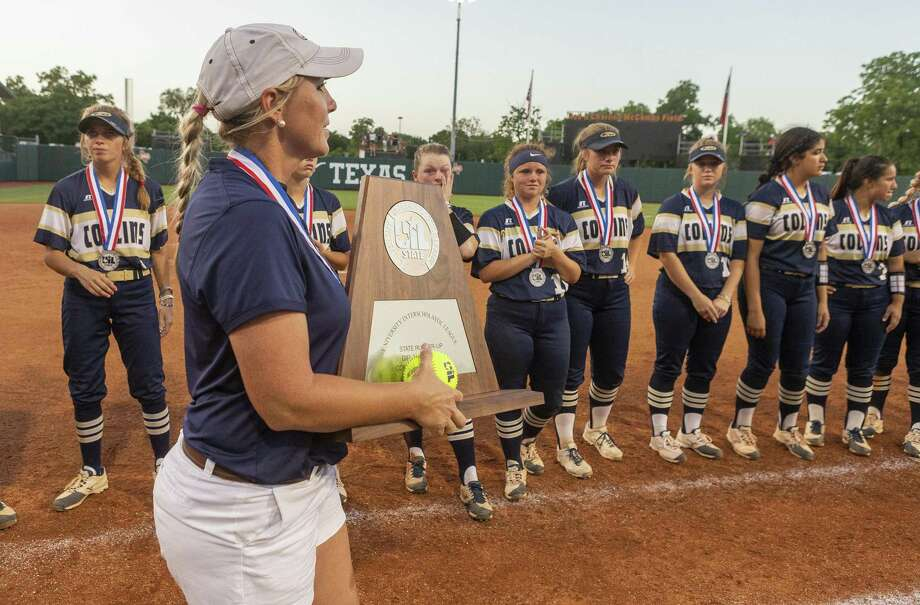Klein Collins head coach Audra Troutman holds the runner-up trophy as the team stands with their silver medals after falling to Katy 8-2 during the UIL Class 6A state softball championship in Austin, Saturday, June 1, 2019. (Stephen Spillman / for Houston Chronicle) Photo: Stephen Spillman / Stephen Spillman / stephenspillman@me.com