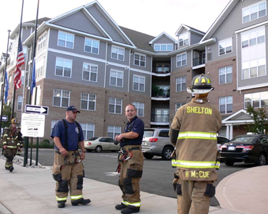 Shelton fire personnel at the scene of a reported gas smell at the Shelton Avalon apartments on Canal Street.