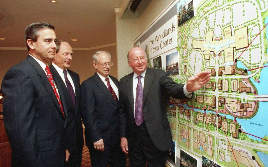 """03/11/1993 - (L-R) Roger L. Galatas, president and chief operating officer of The Woodlands Corp., Donald R. Andrus, Foley's chairman, Richard Welcome, executive vice president of Homart Development and George Mitchell, chairman and president of Mitchell Energy and Development look at a map of the site for The Woodlands Mall. An oil tycoon and real estate developer, Mitchell is often the figure credited for The Woodlands' success. When Mitchell saw the potential of the area to be a master-planned community, he brought others on-board such as Tom Cox, Jeff Harris and Roger Galatas to make it happen. Though Mitchell passed away in 2013, the three other men formed the invitation-only George's Coffee Club in 2016 as a way to honor, respect and communicate George Mitchell's vision for The Woodlands as a place to """"live, work, play and learn"""". Photo: Betty Tichich, HC Staff / Houston Chronicle / Internal"""