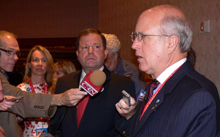 Dave Walker, right, talks to the press at the Republican State Convention in May. To the left of Walker is gubernatorial candidate John McKinney.