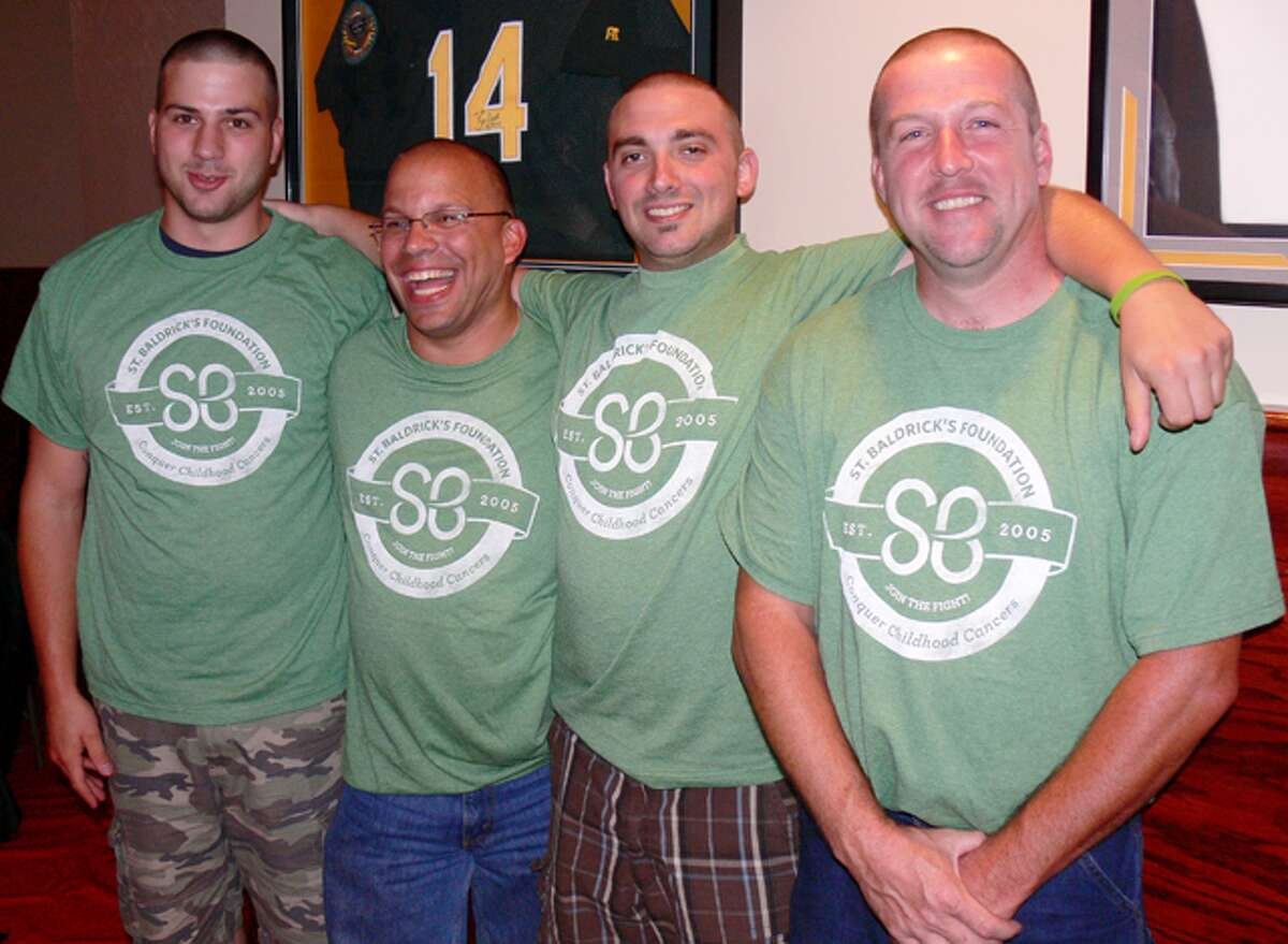 Showing off their new hairstyles are, from left, Huntington firefighters Joey Tassitano, Scott Goldin, Ryan Mattioli and Rob Cummings.