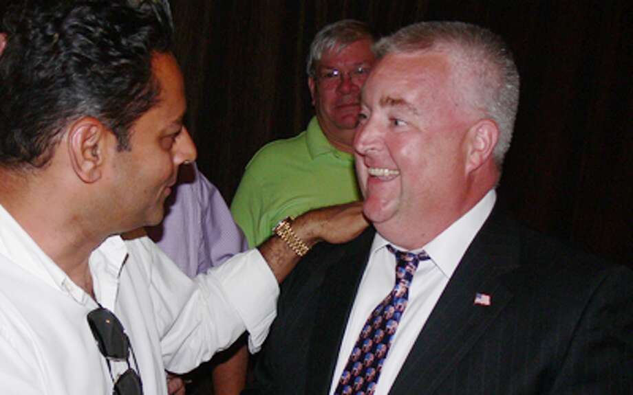 Republican Ben McGorty is congratulated by David Gidwani of Shelton at his victory celebration.