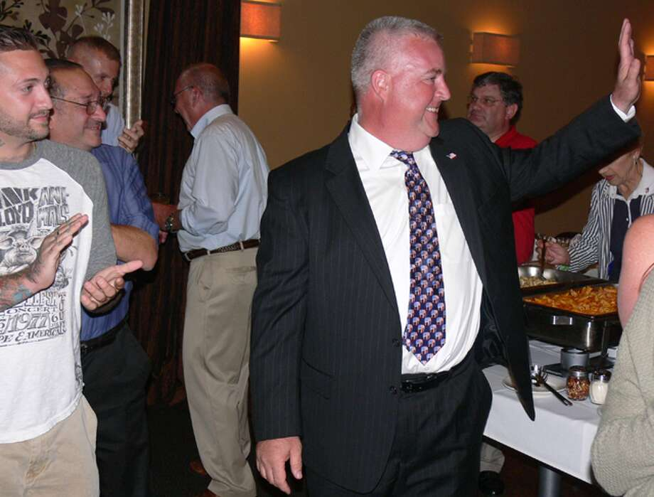 Ben McGorty is congratulated by supporters after winning the special election during a celebration at Vazzy's in Shelton.