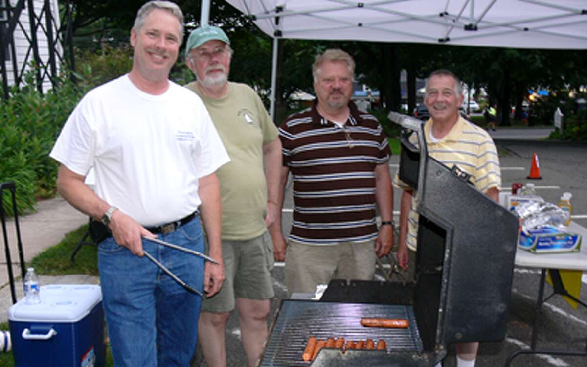 Soren Ibsen of Shelton cooks hot dogs at Huntington Congregational Church for concert-goers at the nearby Huntington Green. Ibsen is a church member.