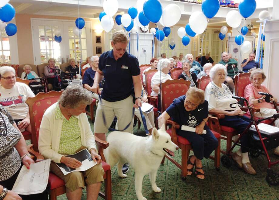 Alisa Geller introduces retiring UConn mascot, Jonathan XIII, to the residents of Crosby Commons assisted living community in Shelton during a party July 7.